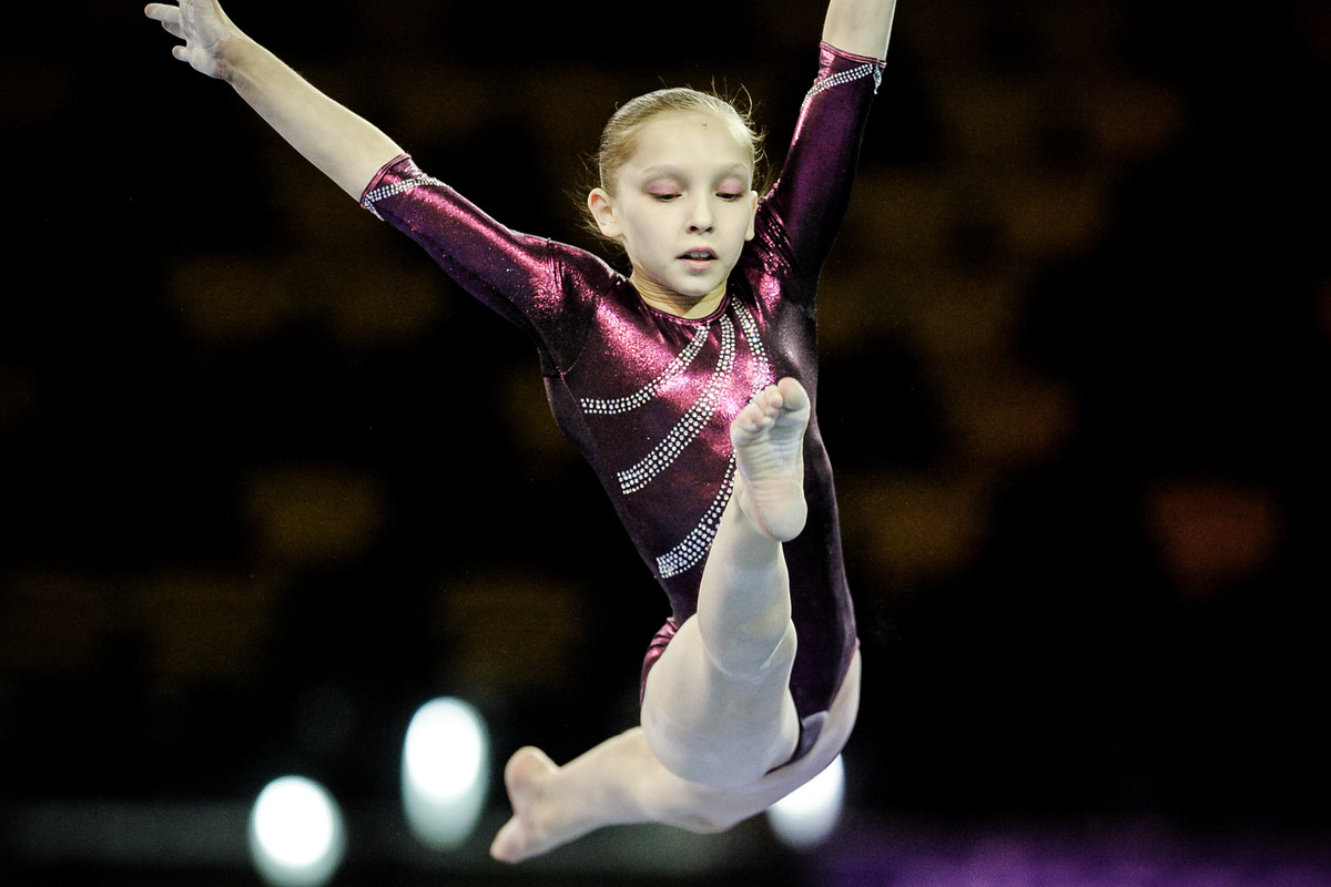 young artistic gymnast in competition