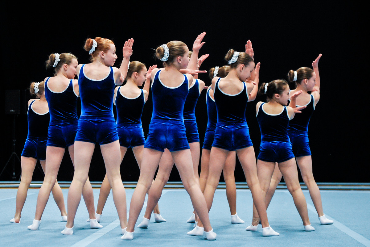 Perfectly in time, TeamGym gymnasts perform their perfected routine in matching