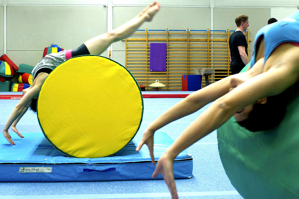 adult gymnastics session with male participants getting ready to train