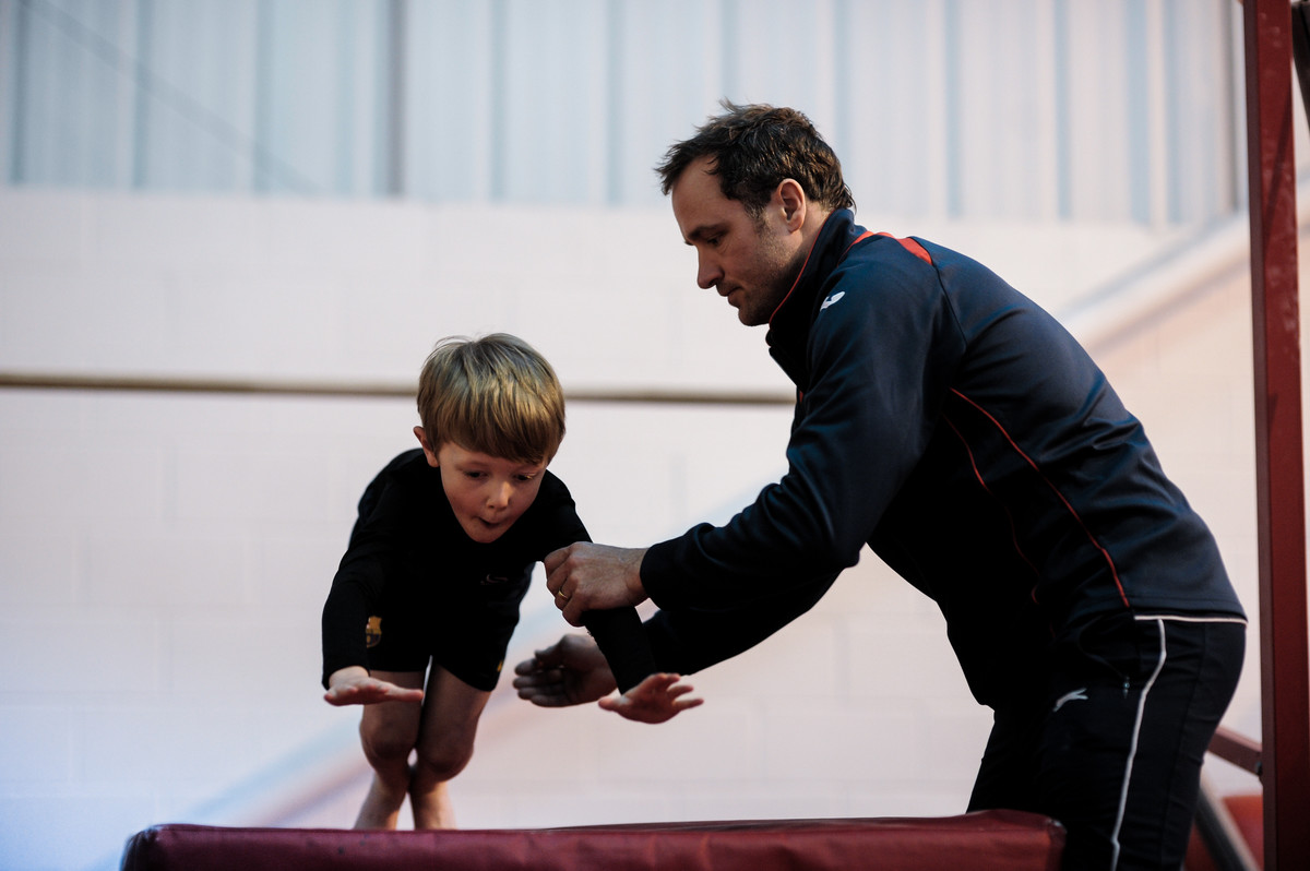 Coaching makes the difference as young gymnast tries out new skills