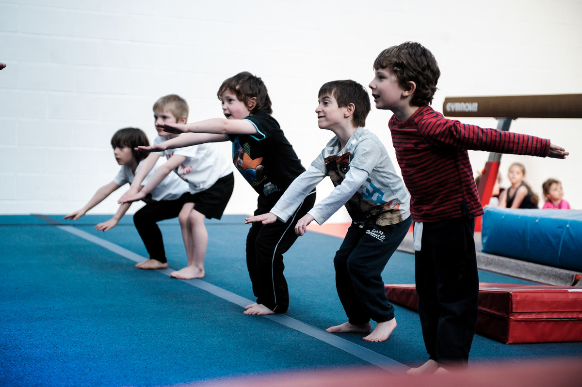 youngsters having fun on the floor apparatus