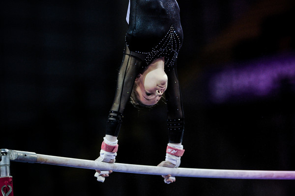 Elite artistic gymnast aces the uneven bars