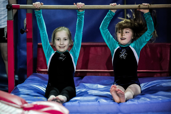 playtime on the bars for two young artistic gymnasts
