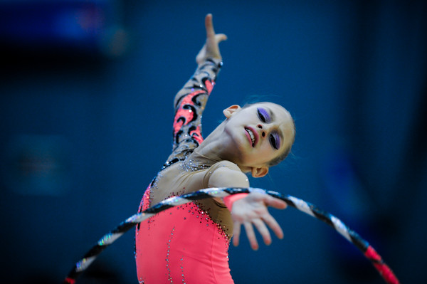 young rhythmic gymnast portraying the emotion of the music