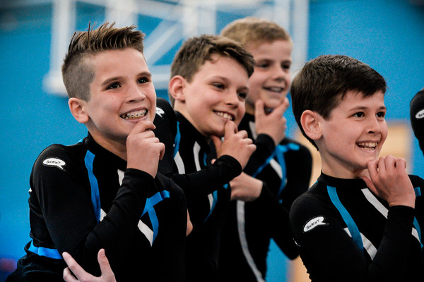 Performing in front of crowds, young TeamGym gymnast lads