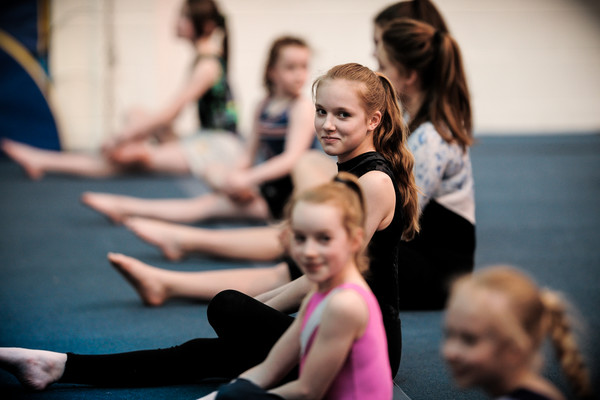 young TeamGym gymnasts at their club warming up