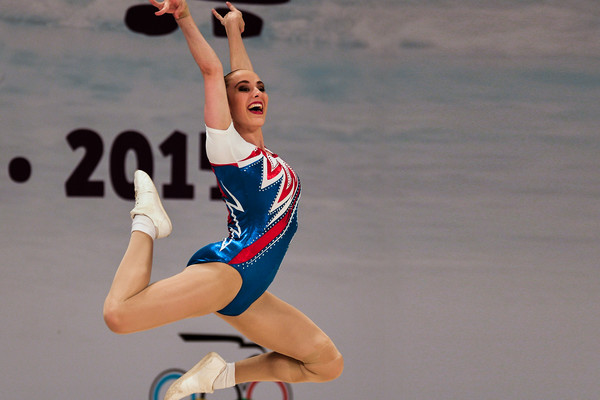 gymnast jumps for joy at aerobic world age group competition