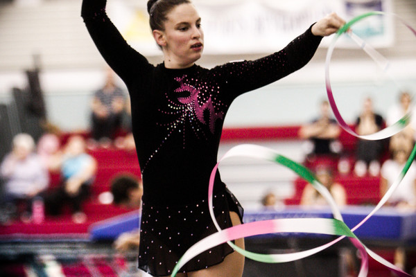 Rhythmic gymnast performs with the ribbon