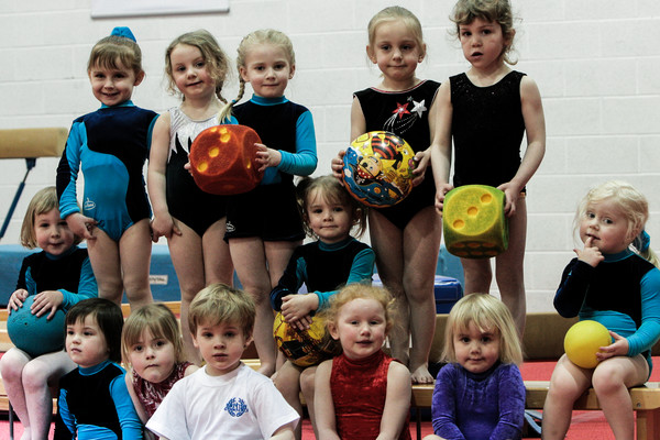 pre-school gymnasts pose for a group photo