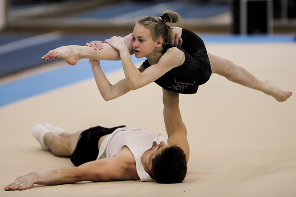 Dominic Smith and Alice Upcott acrobatic gymnasts in competition training